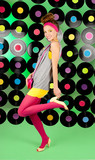 studio shot of cheerful teenage girl over colorful background
