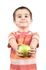 Smiling boy gives apple
