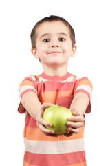 Smiling boy gives apple