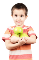 Little boy holding apples