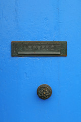Blue door and letterbox