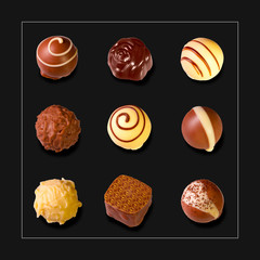 a collection of mixed chocolates against a black background