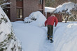 Man shoveling snow after a storm