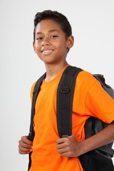Smiling school boy 11 with rucksack ready to go