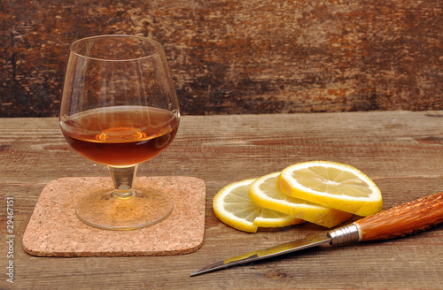 classic cognac with lemon and knife