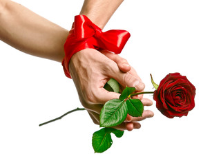 hands are binding by crimson ribbon with red rose