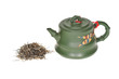 Green Chinese Teapot With Some Dried Yea Leaves