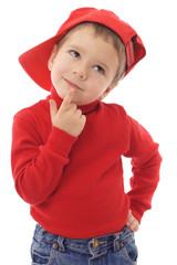 Smiling little boy in red hat thinking about, isolated on white