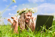 beautiful girl on the meadow with notebook