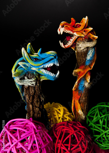 Two dragons climbing on tree isoloated on black background