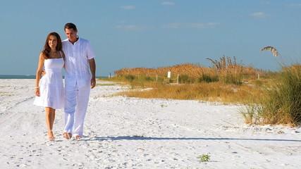 Couple Enjoying Quiet Walk on the Beach filmed at 60FPS