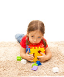 isolated cute girl with a plastic toy poster