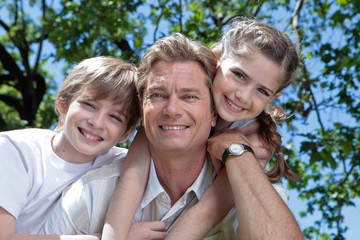 Father and kids smiling