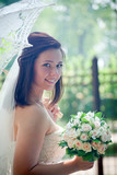 Bride portrait with lacy umbrella poster