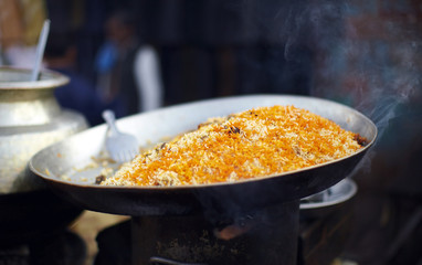 Biryani rice dish with carrots in the market