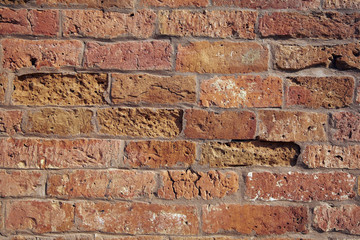 Reddish building block stone brick wall texture