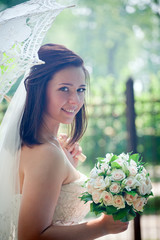 Bride portrait with lacy umbrella