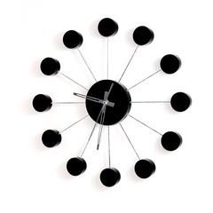 Black wall clock on white background