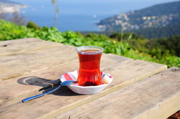 a glass of tea on wooden table