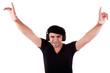 man listening music in headphones, arms raised