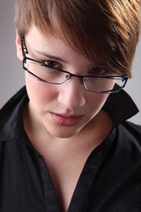 Portrait of a beautiful girl in glasses