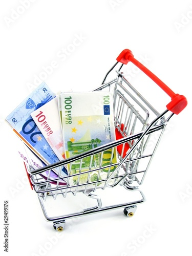 Euro currency in a shopping trolley on a white background