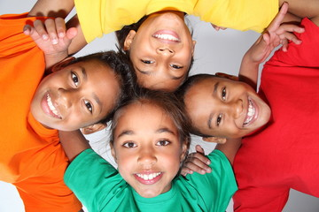 Playful school friends together in huddle