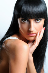 Portrait of a beautiful young woman with long black hair