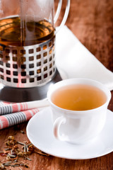 french press and cup of fresh herbal tea