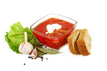 borsch in glass dish. Isolated over white. Shallow DOF