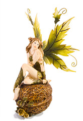 Figure of beautiful garden fairy with green wings