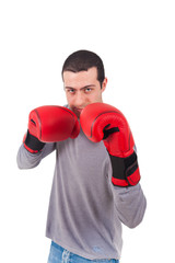 Portrait of young man with boxing gloves over white background