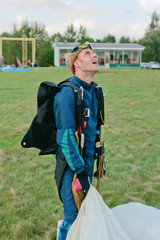 The parachutist after a landing looks in the sky