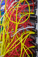 A bunch of network cables in a data center