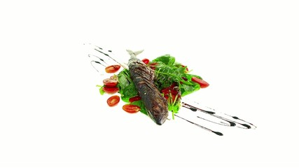 fried mackerel on salad with vinaigrette dressing