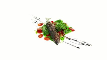 fried mackerel on salad with vinaigrette dressing