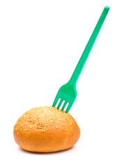 Plastic fork in the bun