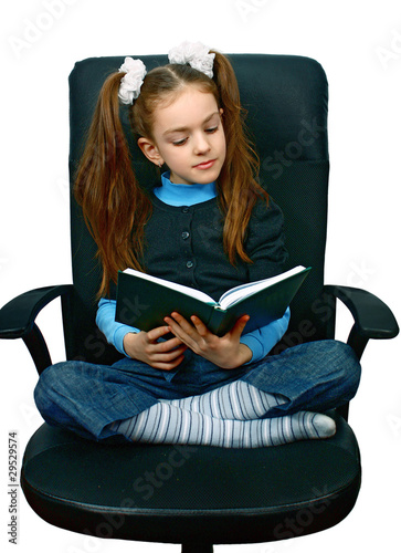 girl reading a book in chair