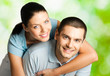 Portrait of young happy smiling amorous couple, outdoors