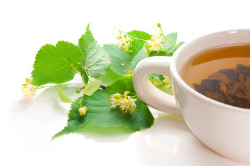 Cup with green tea, with leaflets and linden flowers