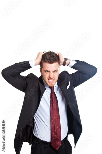 Angry businessman holding hair isolated on white