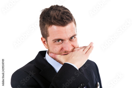 Angry businessman biting his hand isolated on white