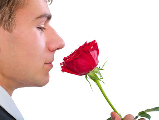 man smelling a rose