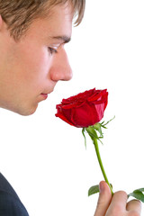 man smelling a rose