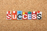 The word Success in magazine letters on a notice board poster