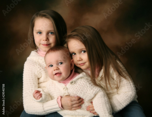 Three young beautiful sisters
