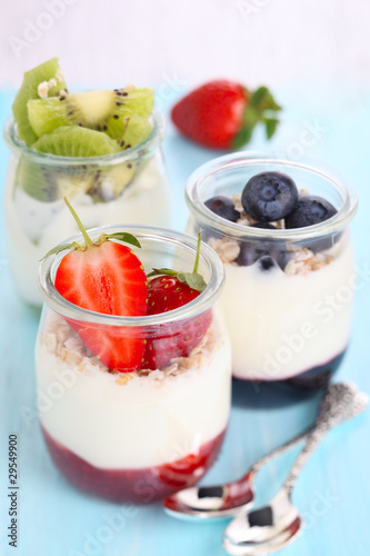 Natural yogurt with jam and fresh berries (strawberry, blueberr