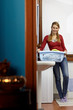 woman doing chores with washing machine