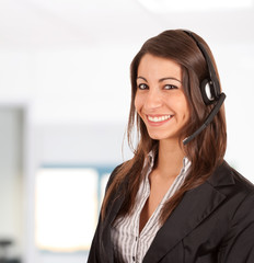 Smiling call center secretary. Office on the background