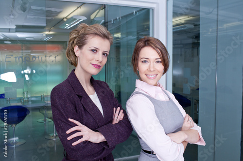 Two confident businesswomen in office